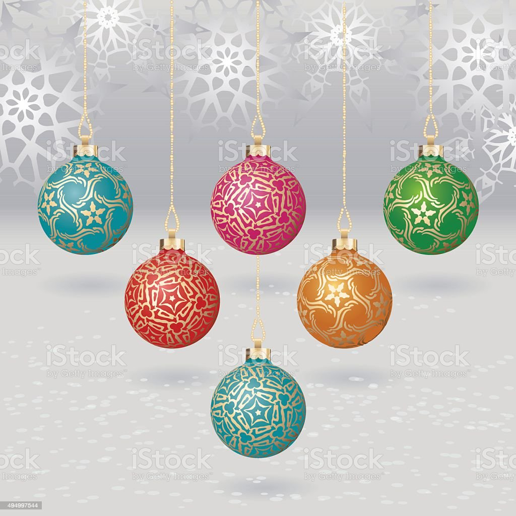 Christmas balls with gold design on light background with flakes vector art illustration