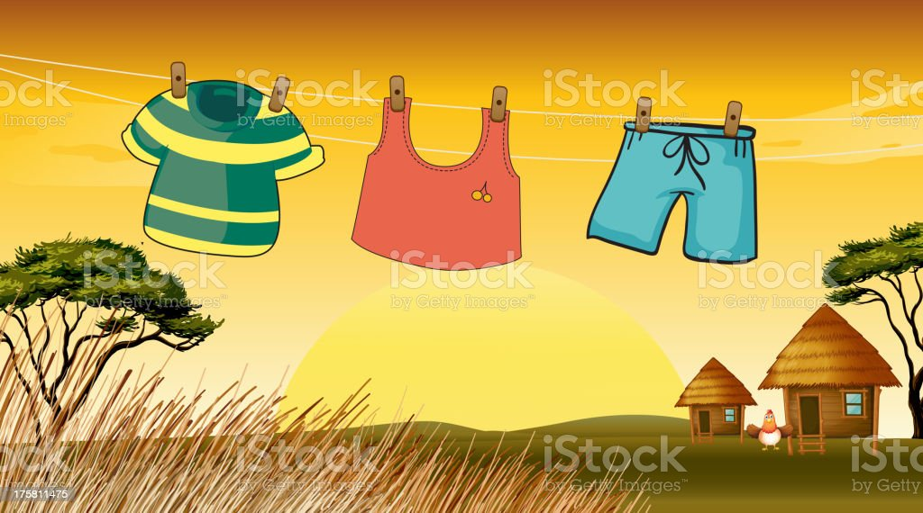 Clothes hanging in the wire royalty-free stock vector art