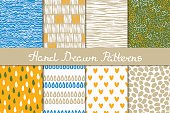 Collection of abstract seamless patterns drawn in ink.