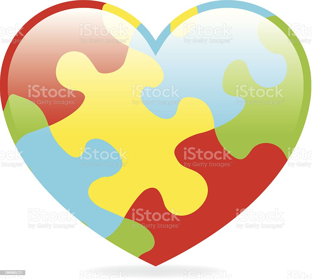 A colorful jigsaw puzzle shaped as a heart vector art illustration