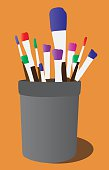 Colorful paint brushes in a can