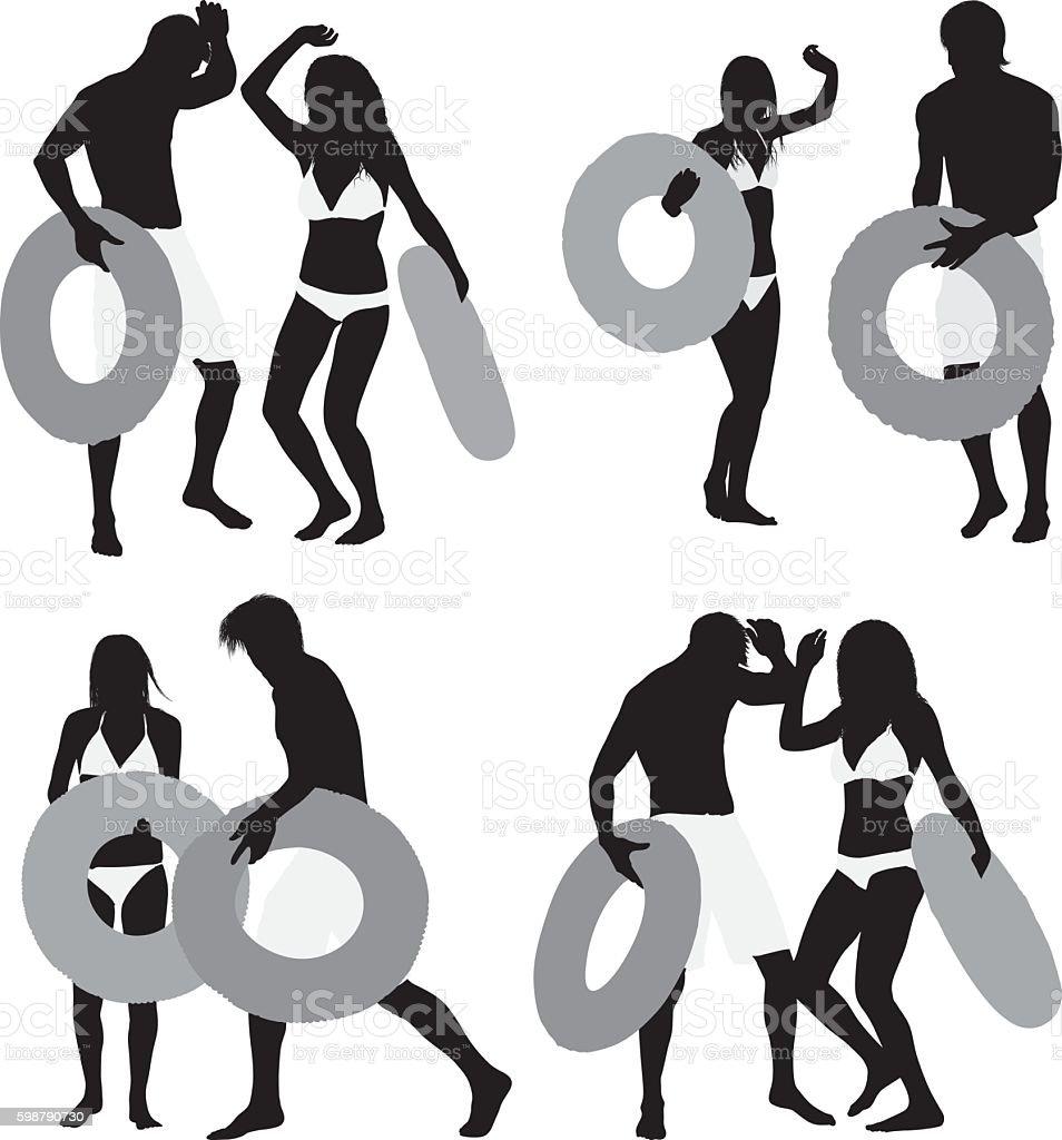 Couple dancing in the rain with inner tube vector art illustration