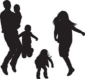 Couple jumping with their children