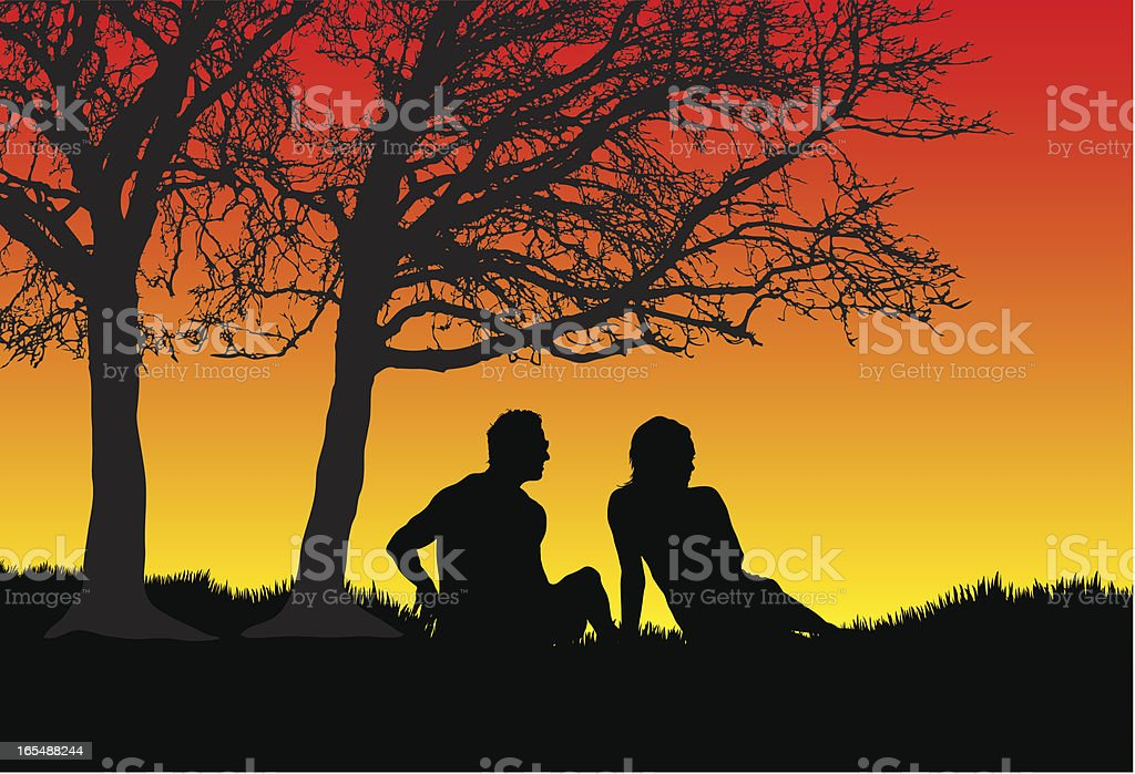 Couple under a tree at sunset royalty-free stock vector art