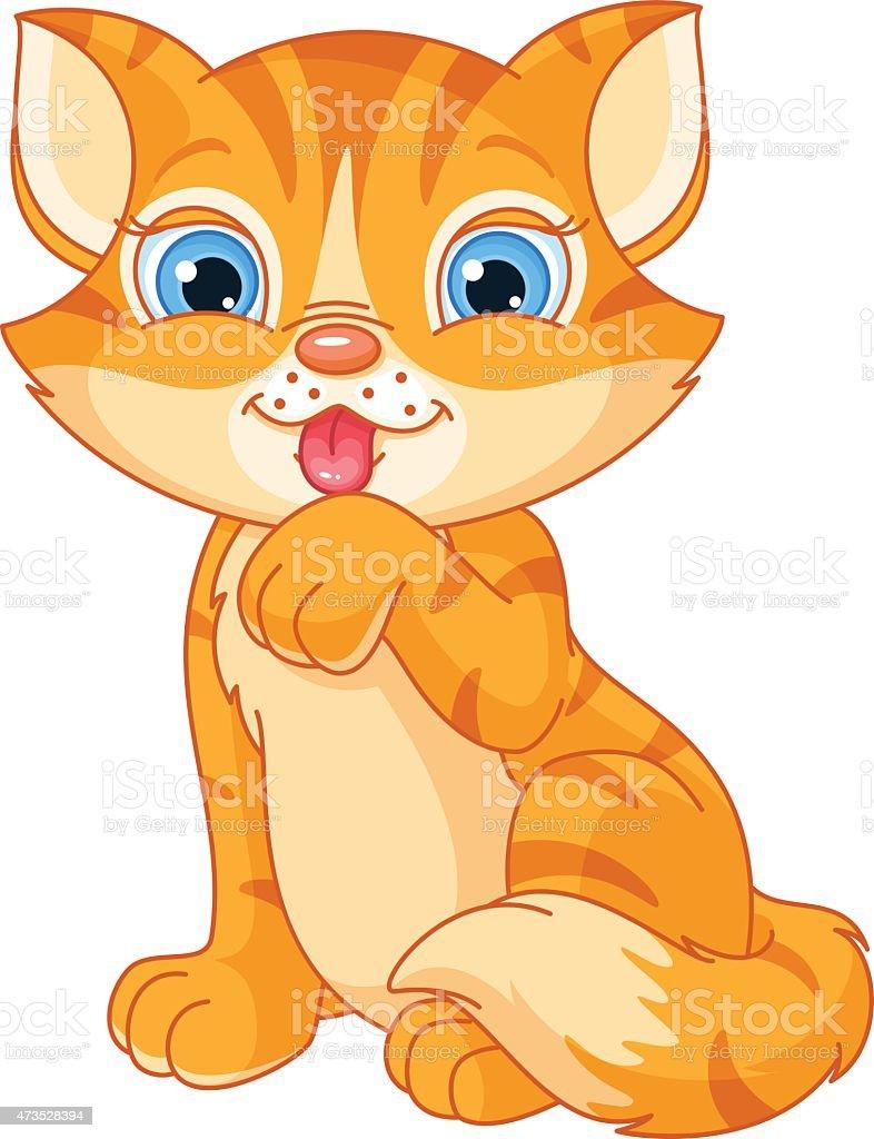 Cute kitten washing itself vector art illustration