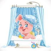 Cute pink little piggy taking a bath with foam