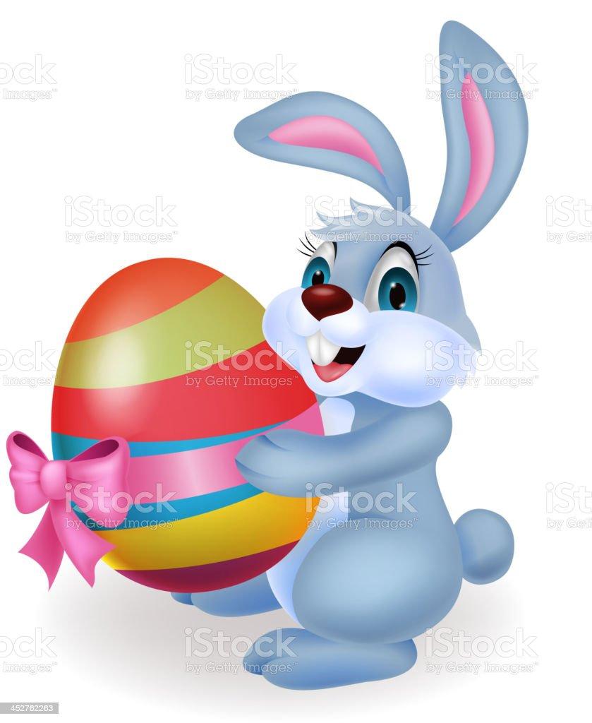 Cute rabbit cartoon holding easter egg royalty-free stock vector art
