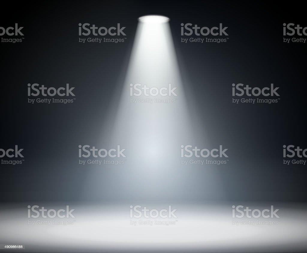 Dark background with spotlight. vector art illustration