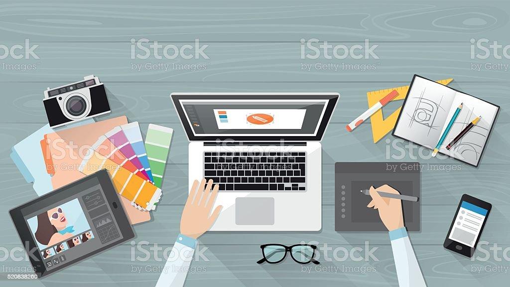 Designer working at desk vector art illustration