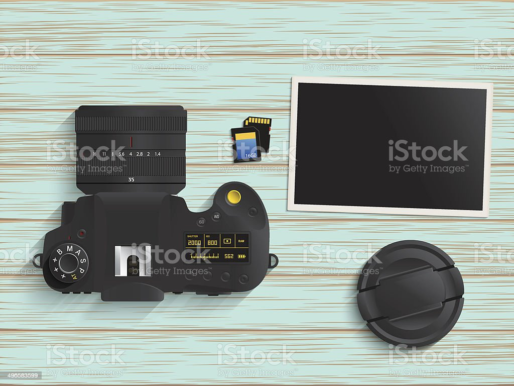 Digital camera, memory card and photo on wood table vector art illustration