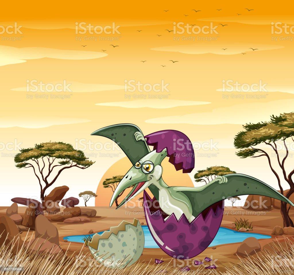 Dinosaur hatching egg at sunset vector art illustration