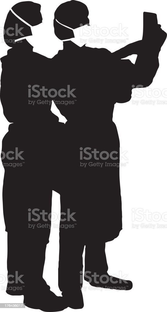 Doctors reading chart silhouette royalty-free stock vector art