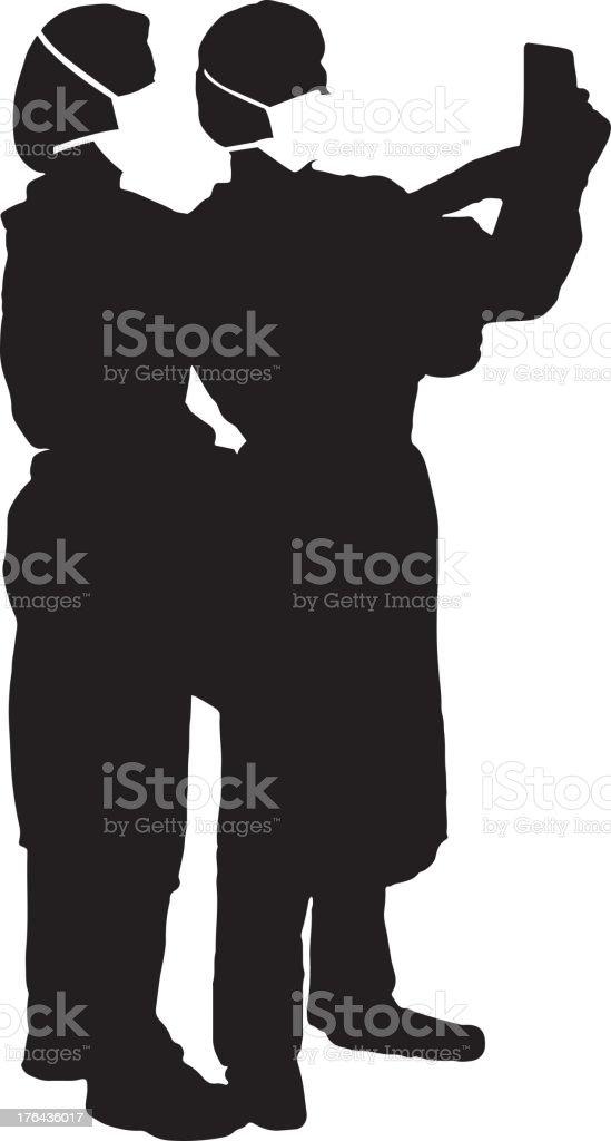 Doctors reading chart silhouette vector art illustration