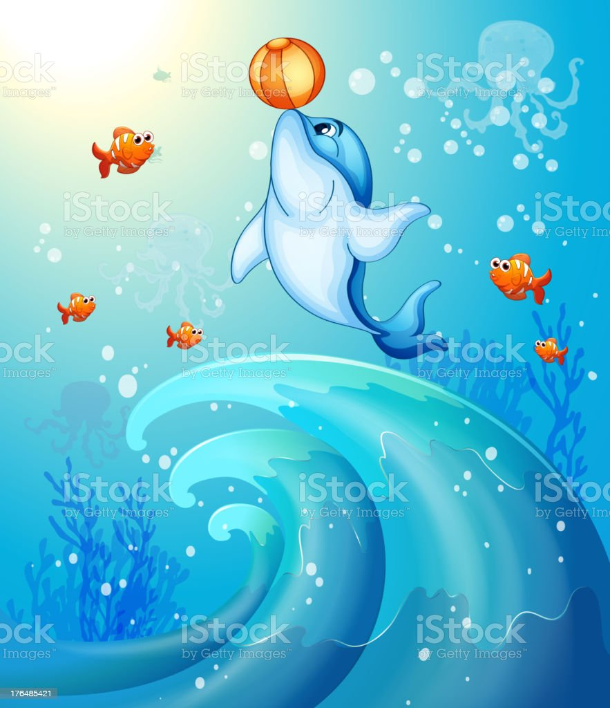 Dolphin playing a ball under the sea royalty-free stock vector art