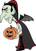 Dracula with pumpkin in his hands