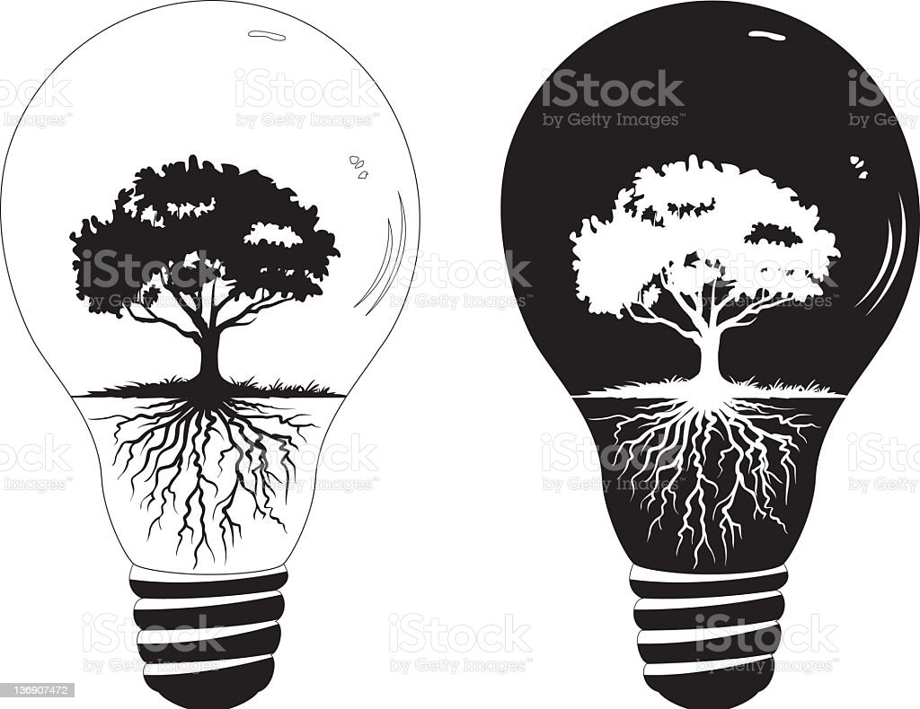 Environmental Awareness old fashioned light bulbs with Tree Silhouette inside stock photo