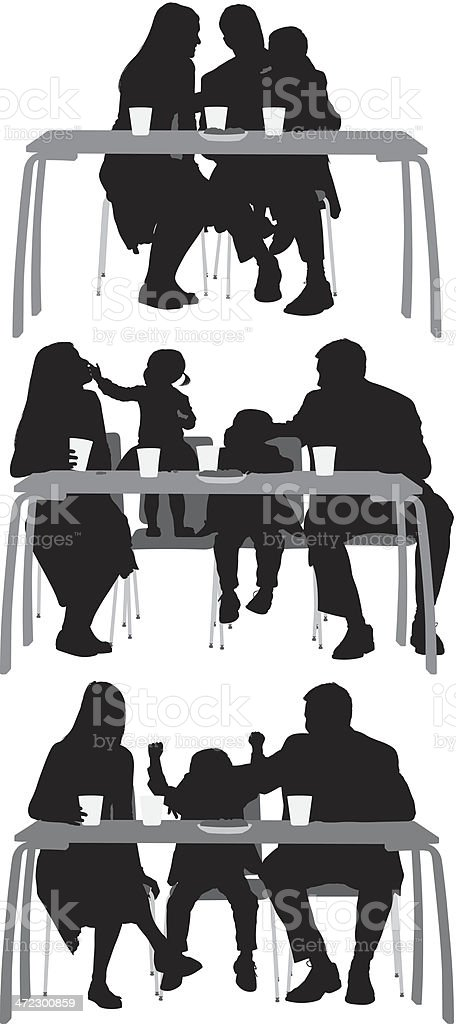 Family eating breakfast together royalty-free stock vector art
