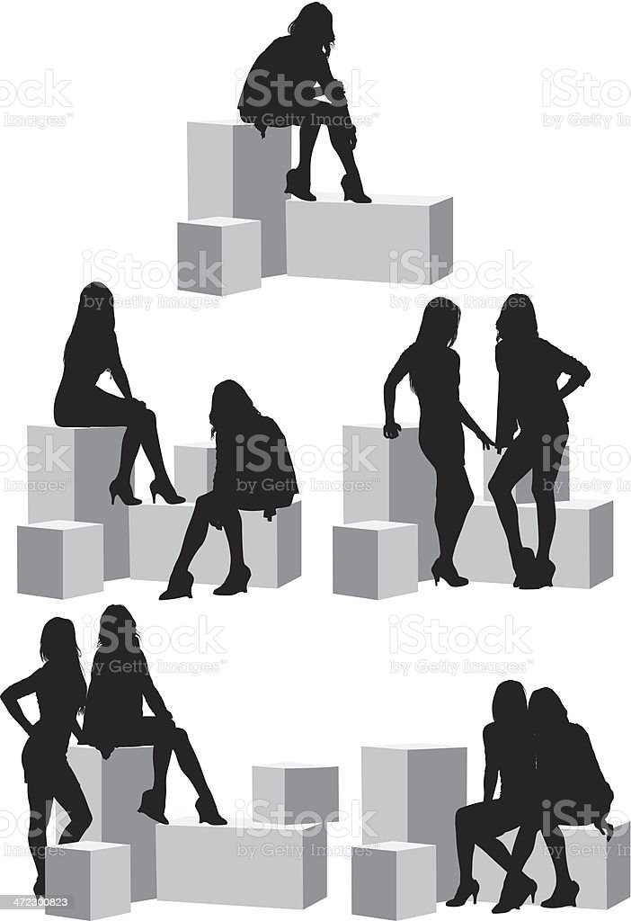 Female friends sitting on boxes royalty-free stock vector art