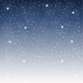 Flying snowflakes on a light blue background.