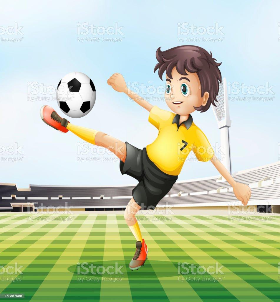 Football player kicking the ball royalty-free stock vector art