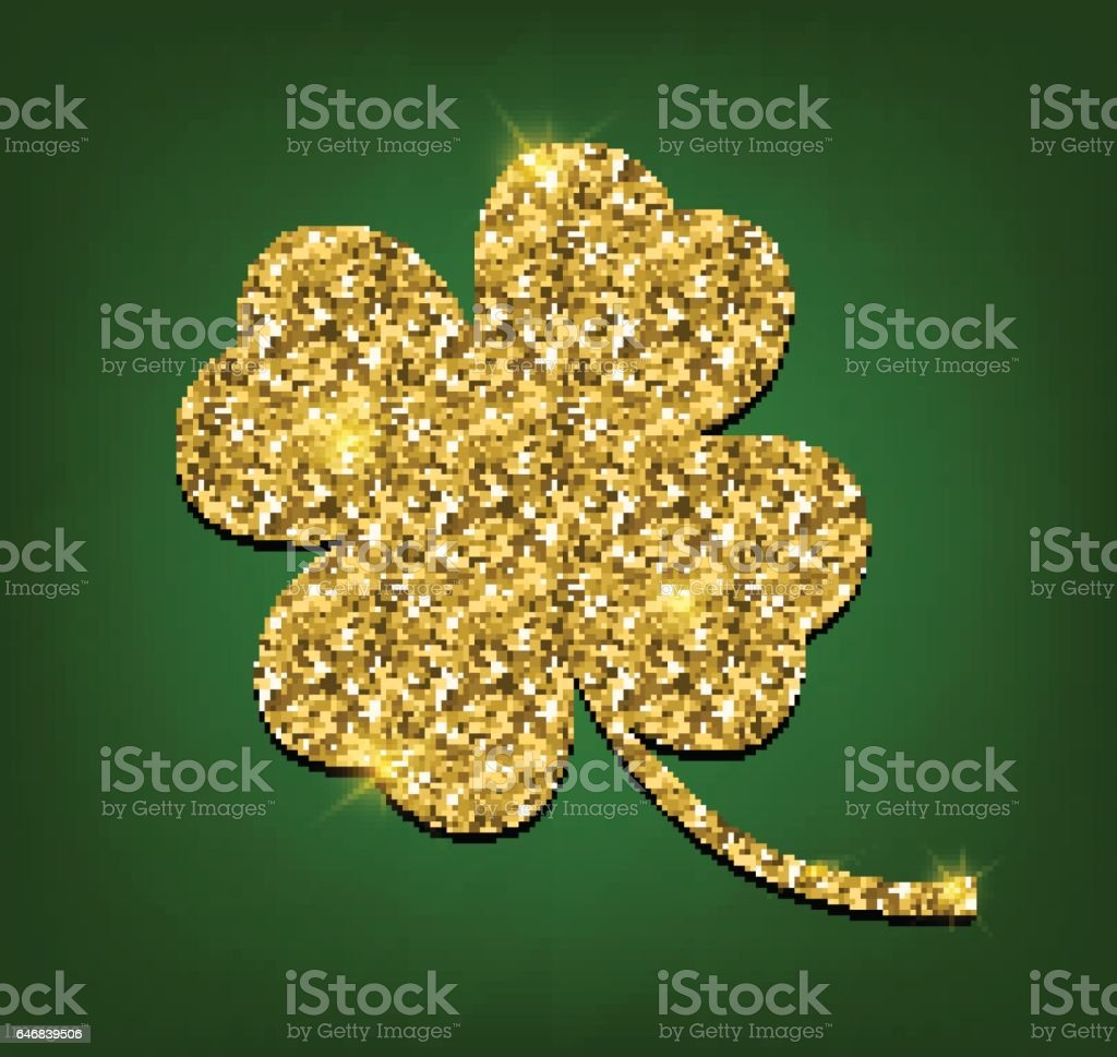 four leaf clover made of gold sand isolated on green background