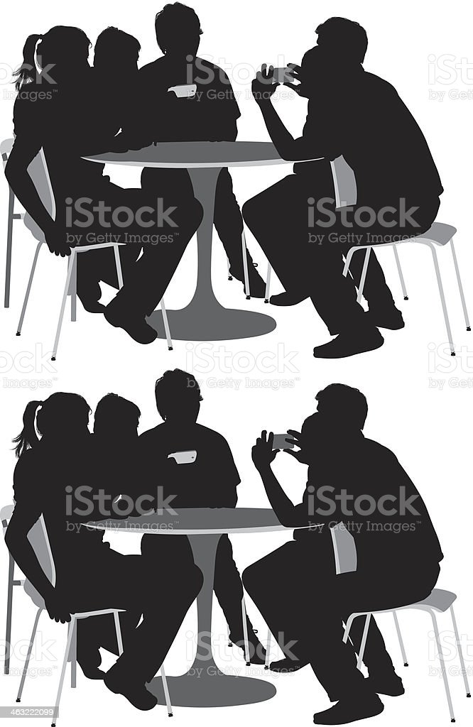 Friends hanging out at a restaurant vector art illustration
