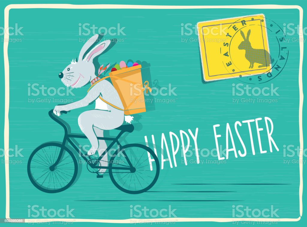 funny easter bunny biking with pannier filled with easter eggs stock photo