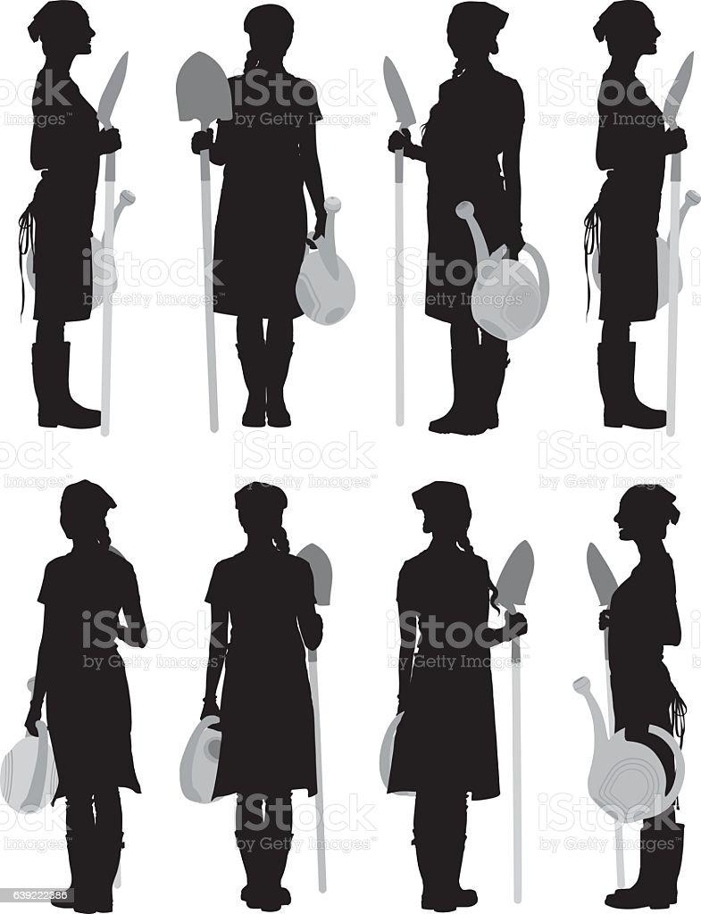 Gardener holding shovel and watering can vector art illustration