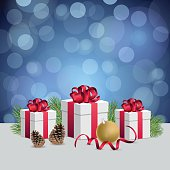 Glowing blue bokeh background and christmas gift boxes with deco