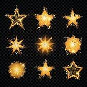 Gold glittering stars sparkling particles on transparent background. golden sparkles