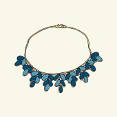 Gold necklace with blue beads
