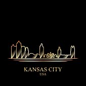 Gold silhouette of Kansas City on black background