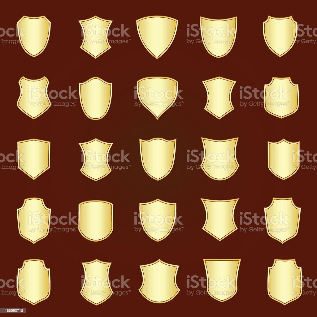 Golden shield design set with various shapes. vector art illustration