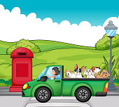green vehicle with dogs at the back