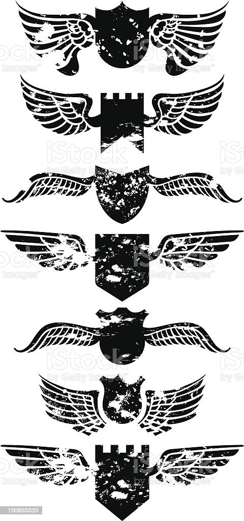 Grunge winged shields royalty-free stock vector art