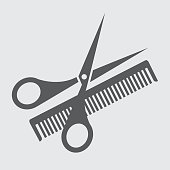 hair salon with scissors and comb - icon