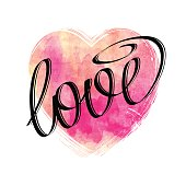 Hand drawn lettering LOVE on watercolor heart