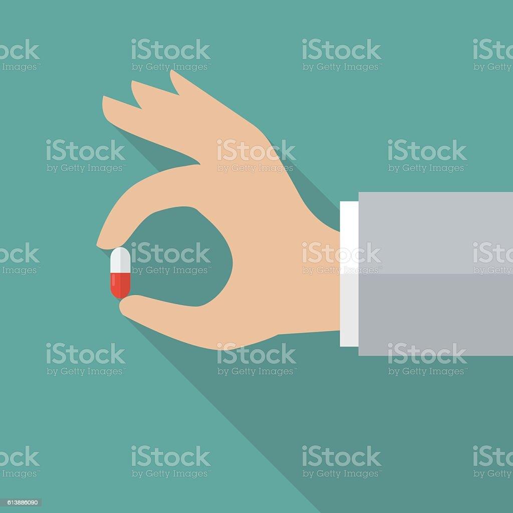 Hand holding medical pill vector art illustration