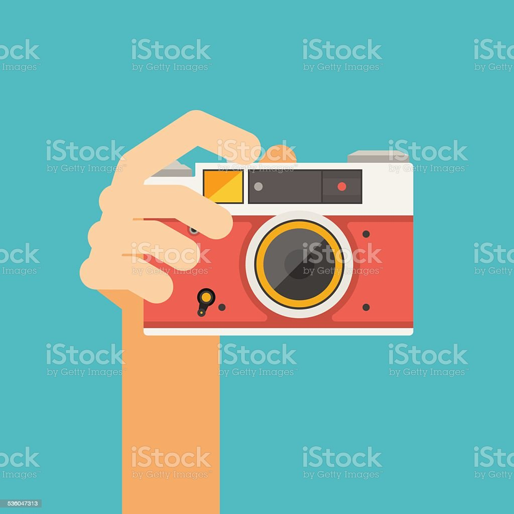 hand holding old camera vector art illustration