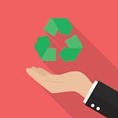 Hand holding recycle icon