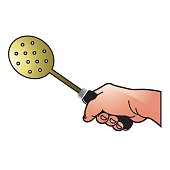 hand holding slotted spoon