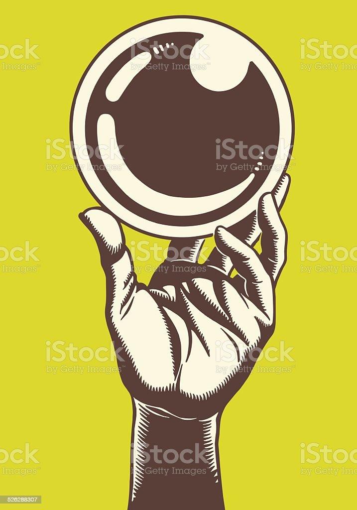 Hand Holding Up a Glass Ball vector art illustration