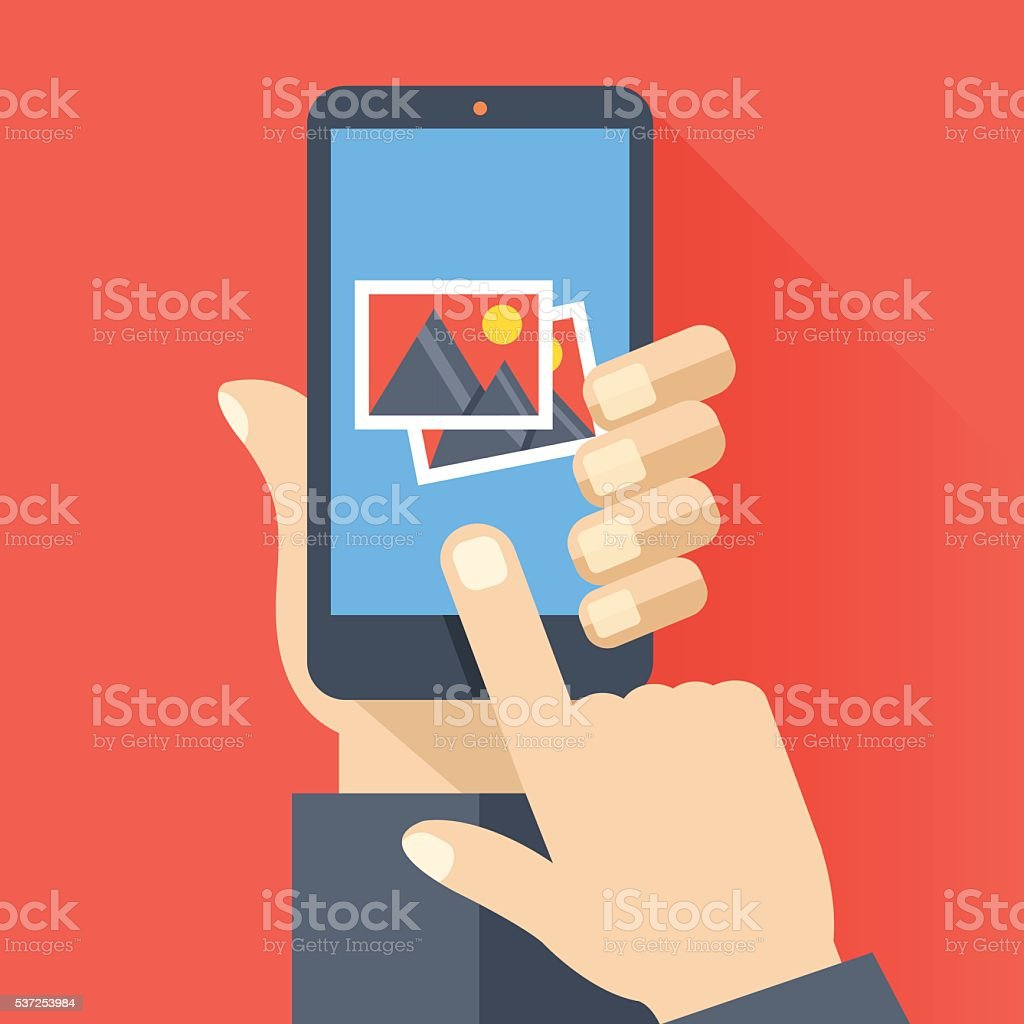 Hand holds smartphone with photos icon. Photo app. Vector illustration vector art illustration