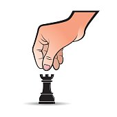 hand moving chess piece rook