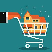 Hand with shopping cart. Real estate broker agent with house