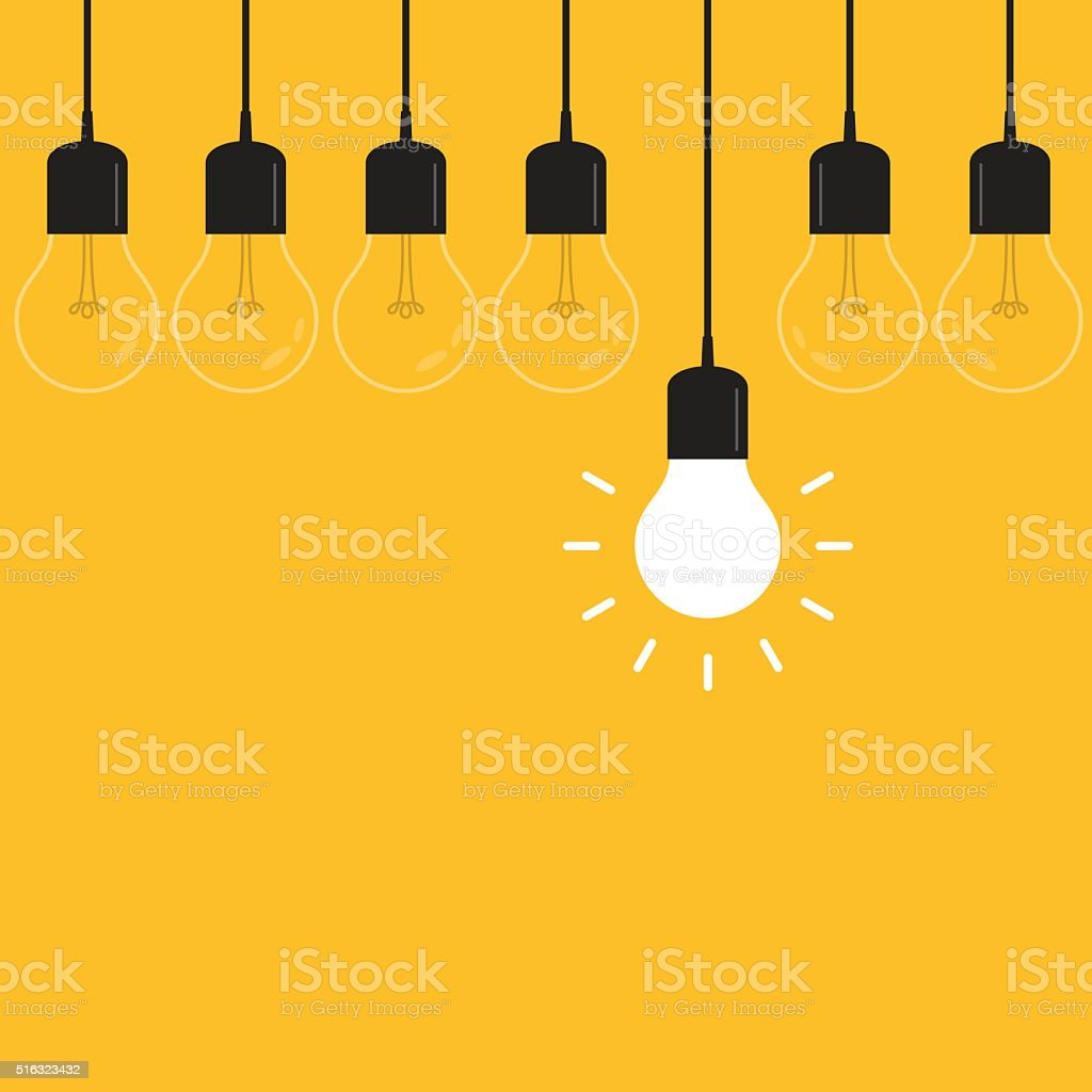 Hanging light bulbs with glowing one on yellow background stock photo