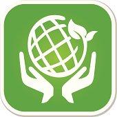 holding eco green world badge