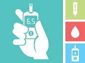 Human hand holding Glucose Meter - Blood Glucose Test