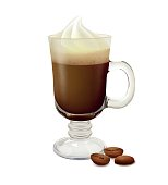 Irish coffee in a glass with coffee beans on white background