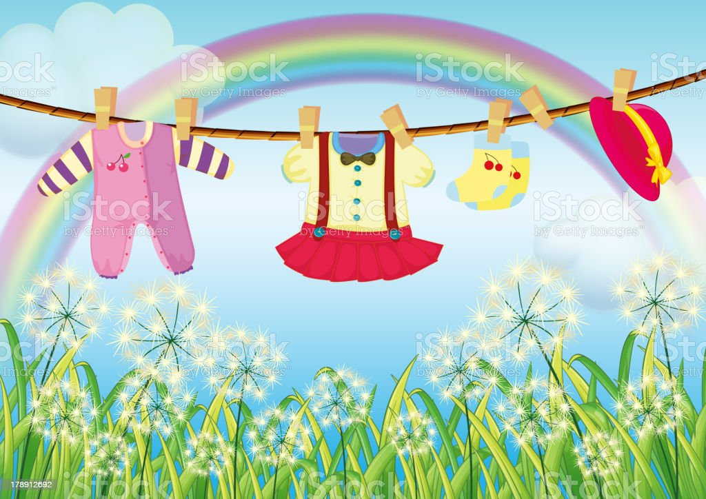 Kids clothes hanging near the grass royalty-free stock vector art